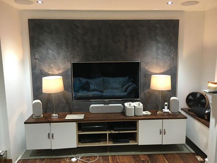 TV area with polished plastering